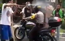 Kasihan Pak Polisi, Mau Dinas Malah Basah Disemprot Desinfektan Cegah Corona, Netizen: Kayaknya Punya Dendam Pribadi