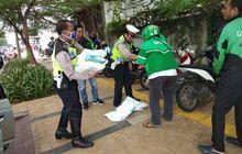 Bantu Riangankan Dampak Corona, Polisi Bagikan Sembako Gratis ke Driver Ojol