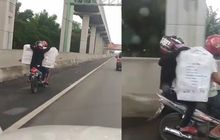 Bekasi Geger, Viral Video Pemotor Ngebut Sambil Mengangkut Barang Masuk Jalan Tol Jakarta-Cikampek