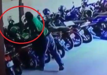 Lihat Parkiran Sepi,  Driver Ojol Tukar Helmnya dengan Milik Ojol Lain, Pelat Nomor Terekam CCTV