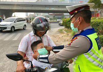 Bikers Wajib Catat! Jangan Turunkan Masker ke Dagu, Begini Alasannya..