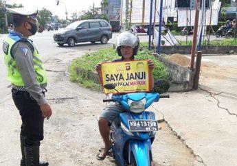Bikers Yang Masih Nekat Tidak Pakai Masker, Mulai 27 Juli Sanksi Denda Rp 150 Ribu Daerah Ini.
