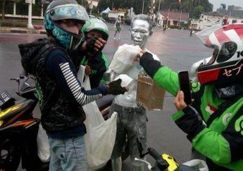 Driver Ojol Punya Grup Namanya ASOOI, Gelar Baksos Bagi-bagi Nasi Kotak Untuk Kaum Dhuafa