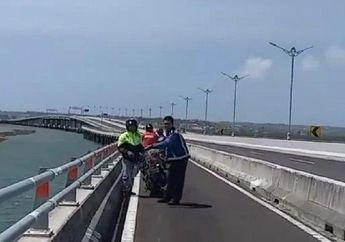 Pengendara Motor Terjatuh Gara-Gara Benang Layangan, Nyaris Nyemplung Ke Laut