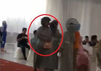 Viral Video Emak-emak Kondangan Tetap Pakai Helm, Warganet Terbahak-bahak