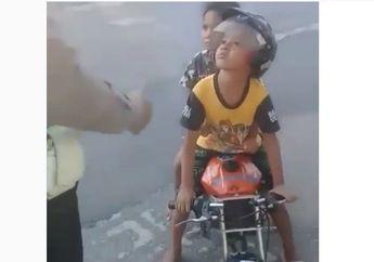 Viral.. Bocah TK Ditilang Polisi Gara-gara Boncengan Naik MiniGP, Ekspresinya Polos Banget