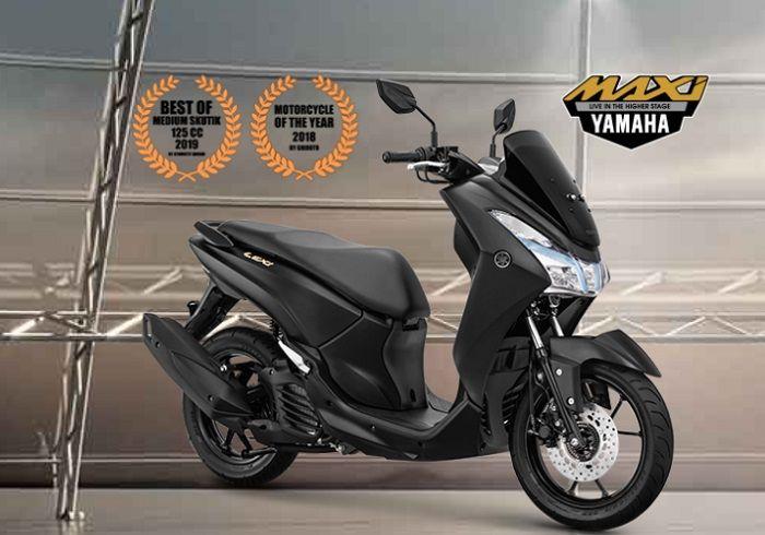 Yamaha Lexi terbaru sudah dipasang emblem gold, lebih mewah dan elegan.