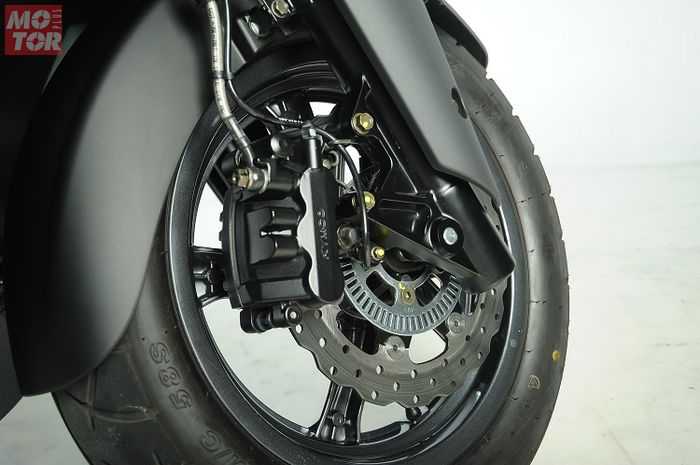 Ilustrasi rem cakram depan sepeda motor dengan fitur rem ABS