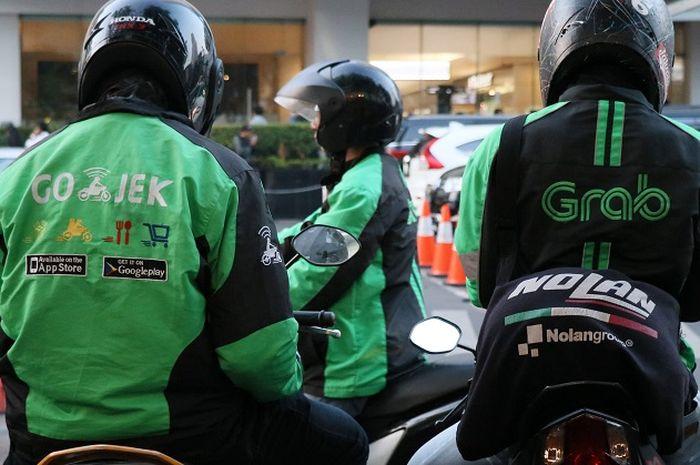 Ilustrasi Gojek dan Grab
