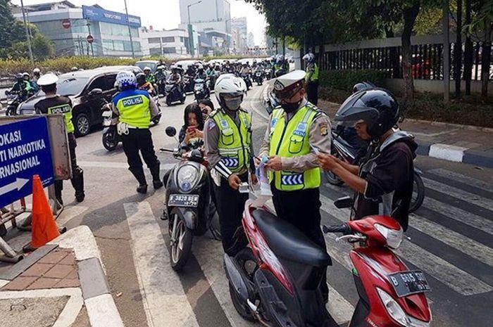 Ilustrasi polisi sedang melakukan Operasi Patuh Jaya di 16 lokasi