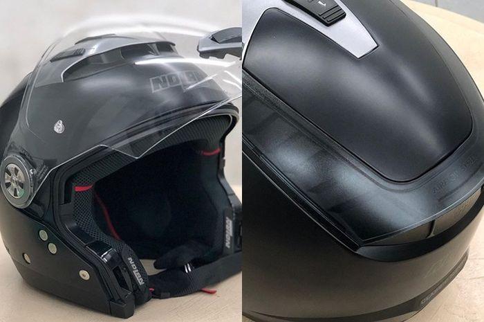 Helm Nolan N44 warna hitam doff diberi lapisan ceramic coating
