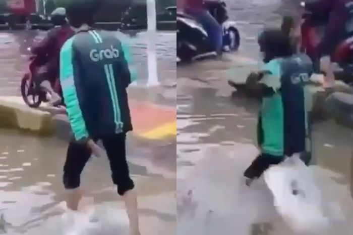 Driver ojek online terjatuh masuk lubang saat banjir Jakarta