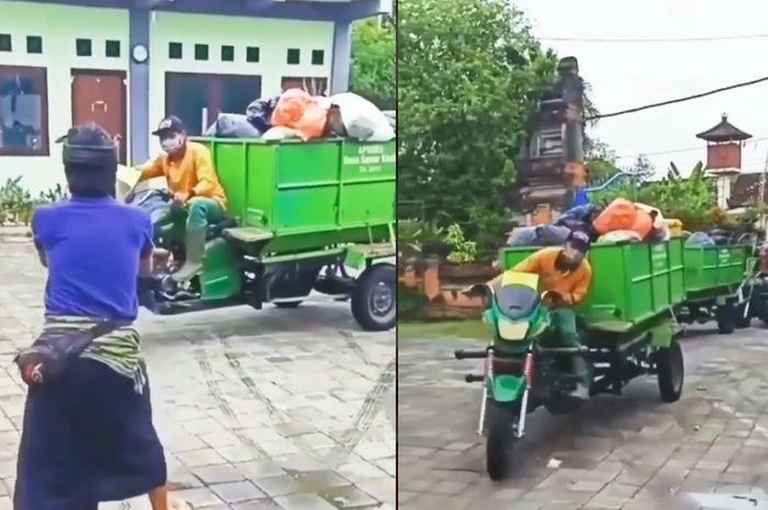 Para petugas kebersihan bermain tik-tok menggunakan motor roda tiganya