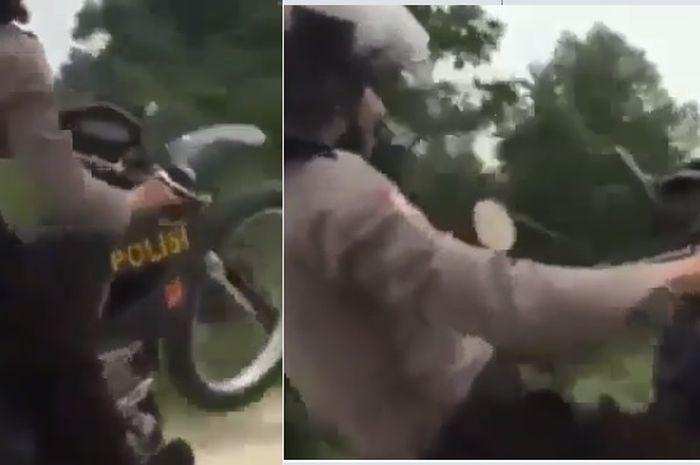 Pak Polisi melakukan aksi wheelie saat patroli