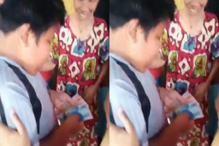 Rizal, bocah penjual gorengan yang sempat dihajar remaja mirip geng motor bisa tersenyum kembali.