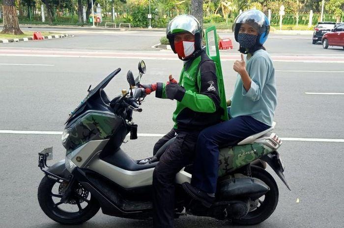 Ilustrasi naik ojek online sebaiknya  menggunakan helm pribadi