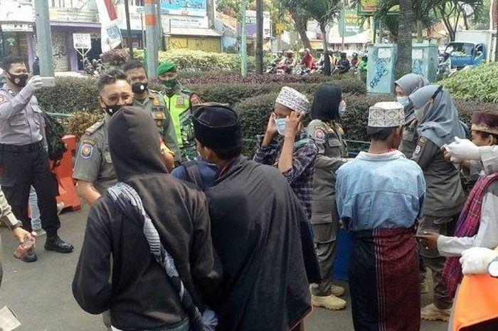 Ilustrasi razia masker.  Di Jalan Siliwangi, Pancoran Mas, Kota Depok, Senin (24/8/2020) lalu