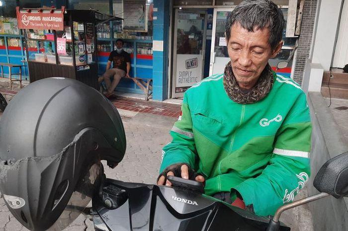 Dapat orderan fiktif dan tertipu sampai tabungannya terkuras, kini driver ojol di Semarang ini tersenyum lebar