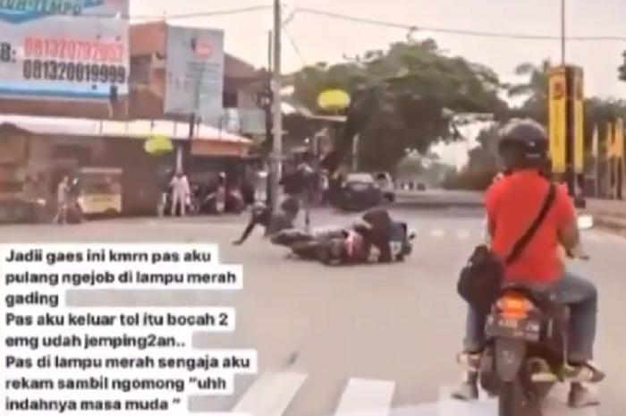 Pemotor trail mau wheelie malah ditabrak emak-emak pemotor yang trobos lampu merah