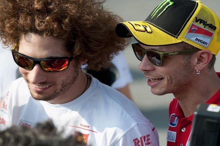 Marco Simoncelli dan Valentino Rossi.