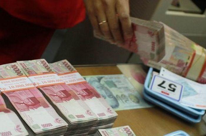 Uang ilustrasi bantuan pemerintah untuk UMKM atau BPUM