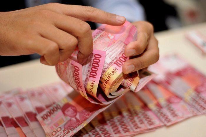 Ilustrasi uang tunai. Ajukan pinjaman tanpa agunan lumayan buat tambahan modal bengkel.