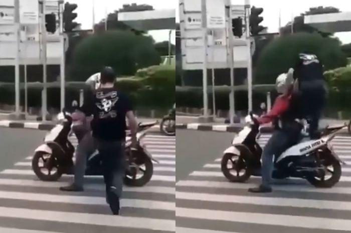 Jok motor diinjak saat berhenti di zebra cross.